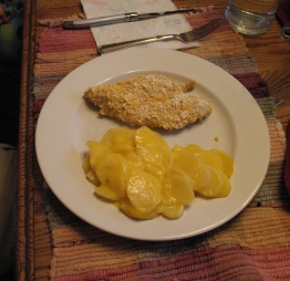 Breaded and baked chicken breast with au gratin potatoes